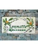Plaque chiffre de maison faience émaillée décor fleurs vertes
