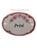 Plaque ovale de porte en faience blanche avec inscription Privé décor fleurs reproduction vieux moustiers rose