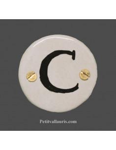 Médaillon céramique ronde bord et inscription noire