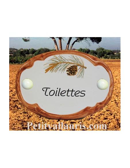 Plaque de porte ovale en faience blanche décor pignes de pin inscription Toilettes