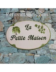 Plaque en céramique émaillée pour maison de forme ovale décor artisanal arbre et feuille de tilleul
