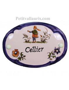 Plaque de porte modèle ovale décor tradition motifs polychrome et bord bleu avec inscription Cellier