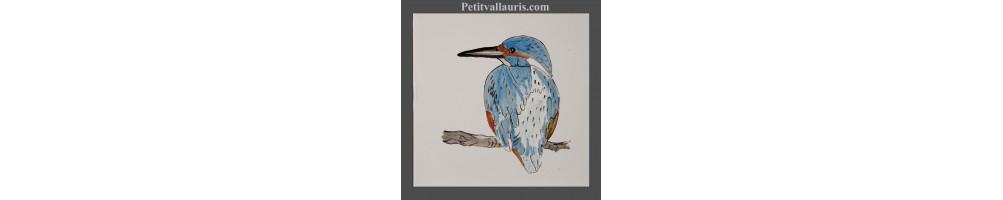 Carrelage en faience avec des décors d'oiseaux effectués à la main